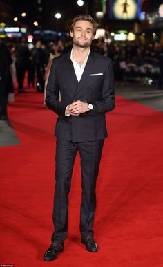 Dapper display: Douglas Booth looked handsome in a dark tailored two-piece suit...