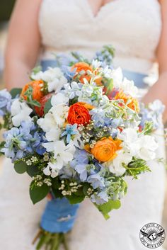 Spring bridal bouquet of orange and blue. Bouquets of Austin | Rebel with A Camera| Nature's Point