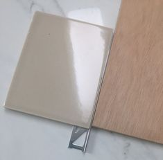 Stainless Trim Transition Piece between change in flooring