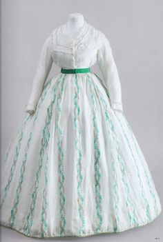 1866 sheer dress, Summer WC, approx 1866 muslin bodice with embroidery, muslin skirt with vertical belt of green silk taffeta skirt to match the pattern. Typical silhouette 60s - wide crinoline skirt on, high waist.