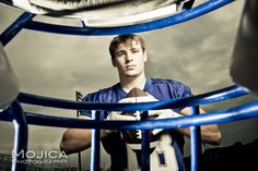 Senior Photography Session: football - interesting concept through the helmet...