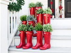 Love using the red rubber boots for containers!!! Bebe'!!! Plant with holiday greens like cedars, junipers, fir and spruce trees!!!