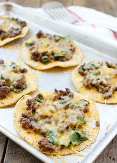 Cheesy Beef, Black Bean, and Spinach Tostadas are a great {20 minute} meal any day of the week! Get the recipe at barefeetinthekitchen.com