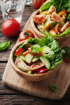 Pic: Concept of healthy food: salad with tomato and cucumber