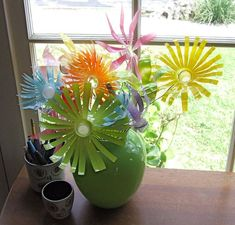 I really want to try this one with plastic bottles and spray paint.  Automatic flowers.