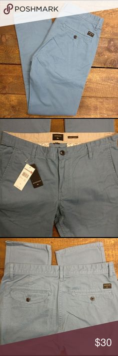"Quiksilver Men's Everyday Chinos Cotton - Blue Quiksilver Everyday Chinos in ""Captain's Blue"" Chino pockets  Cotton twill peach finishing  10.2 oz. fabric  Easy straight fit with regular thighs and straight leg  Inside waistband with contrasted color  Printed pocket lining  Heavy enzyme wash & silicone softener wash  100% cotton 30"" Waist 31.5"" Inseam Quiksilver Pants Chinos & Khakis"