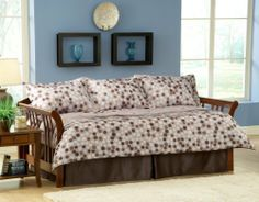 Finn 5-Piece Twin Daybed Bedding Set by Universal Lighting and Decor. $139.91. The Finn daybed ensemble features a stylish taupe background with a varied pattern of circles in light blue, brown, taupe and beige. The comforter features layered pleats that add depth and texture to the overall design. Please note, not all items pictured are included. Please refer to the bullet points below for a list of all items.. Save 33%!