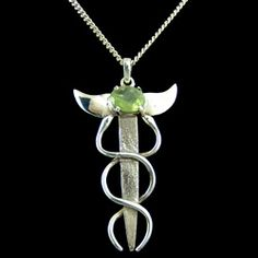 Silver & Peridot Caduceus Pendant - 50mm http://www.crystalage.com/online_store/silver-and-peridot-caduceus-pendant-50mm.cfm
