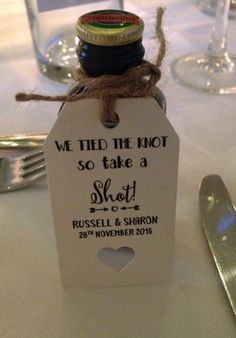 shot bottles for wedding favours. Great idea got everyone going! Personalised tags bought from eBay. #weddingring