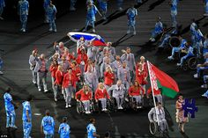 Protest: The Belarusian team defied Paralympic chiefs and entered the stadium waving a Russian flag in apparent support of their controversially banned neighbours