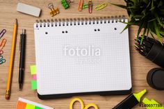 Open notepad with office supplies