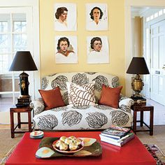 Decorate with Yellow | Use a creamy shade of yellow as an accent wall in your living room. Artwork pops against the neutral background. | SouthernLiving.com