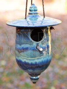 "Love, love, love, this one! 2x Blue Midnight with stripes of Seaweed and Oatmeal followed by slip-trailed Oatmeal and a little more slip-trailed Blue Midnight. Over-fired to cone 7 after 3 failed under-firings. BMix 5. ""Moonsbrooke Manor"" birdhouse by Fox Run Pottery, removable lid for easy-cleaning and with bottom finial drain hole. Available at Spectrum Gallery, Centerbrook, CT in their online store."