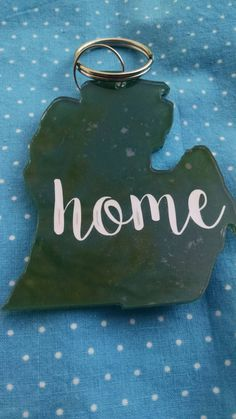 Michigan State home keychain https://www.etsy.com/listing/228749606/green-and-white-michigan-mitten-home