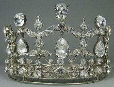 silver plated tiara with hanging crystals.