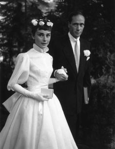 Audrey Hepburn and Mel Ferrer on their wedding day. Audrey's dress was designed by Balmain.