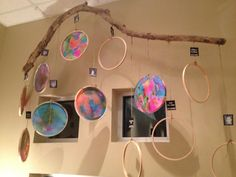 I adore this idea! Notice in the first photo there are empty hoops hanging. On the childs birthday they decorate and fill their hoop. There is glitter involved as well - love the sparkle!!! The childs photo and birthday are attached to the jute holding the hoop. Love. Totally.