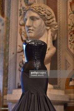 A creation by Tunisian-born, Paris-based couturier Azzedine Alaia is displayed during the press preview of the exhibition ' Azzedine Alaia's soft sculpture' at the Galleria Borghese in Rome on July 10, 2015. The exhibition will run from July 11 to October 25, 2015. Visitors can see Alaia's work displayed in the middle of the permanent collection of scluptures and furnitures of the Villa Borghese.