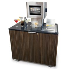The Robotic Bartender - Hammacher Schlemmer.  For $25,000 this computerized home bartender is the perfect way to make mixed drinks.