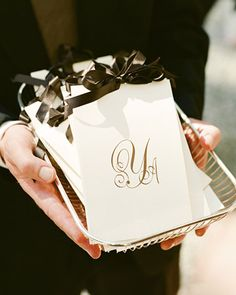 A simple monogram makes for a sleek ceremony program accent