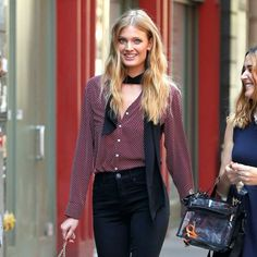 Constance Jablonski - The Streets of Style, Models Off Duty- great red & black blouse with a black tie and black trousers