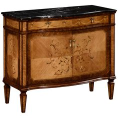 Striking satinwood bow fronted side cabinet with marble top, the two doors and drawer with contrasting floral inlays and finely cast swagged handles, all raised on tapering block feet. Features: - Ver