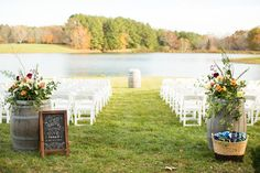 Trump Winery Wedding by Olympic Lake Wine Barrel Flower Arrangements Chalkboard Sign Lakeside Wedding Trump Winery Barn