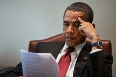 President Barack Obama reads a document in the Outer Oval Office in 2011 - Pete Sousa/The White House