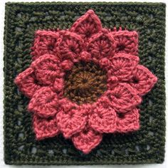Imagine a whole afghan of Dahlia squares with flowers in different colors! This croco-flower has a lot of potential: from the side it looks a lot like a lotus because of the way the petals curve, and from the top it could be a dahlia, a sunflower or a mum. This Crocodile Stitch Afghan Block …