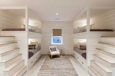 Excellent cheap bunk beds with stairs in the beach-style bedroom with built-in beds next to twin ove Cheap Bunk Beds, Bunk Beds Small Room, Double Bunk Beds, Bunk Beds Built In, Bunk Beds With Storage, Modern Bunk Beds, Bunk Beds With Stairs, Cool Bunk Beds, Bunk Rooms