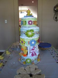 How do you make the perfect diaper cake?  Just take a look below! This diaper cake is AHHH-MAZING! The bright colors and flower accents are divine.  And