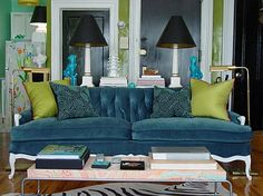 the most glorious blue velvet sofa with chartreuse pillows and turquoise accents behind... *swoon*
