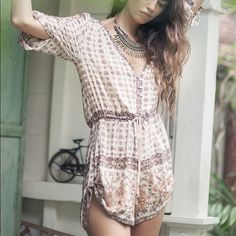 Desert Rose Romper CREAM COLOR Desert Rose Romper. Size Medium. Only worn twice. really just listing to see what offers I'll get so feel free to send some. Free People Tops