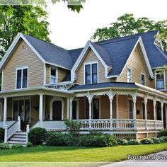 Expansive wrap around porch with gingerbread trim evokes feelings of nostalgia and afternoons spent with grandma.