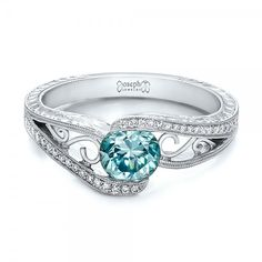 Custom Blue Zircon and Diamond Engagement Ring from Joseph Jewelry via @offbeatbride