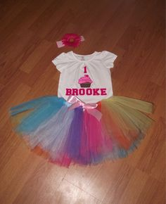 I love this first birthday tutu set. The colors are gorgeous! I love that they can be personalized and customized in any way possible. :)