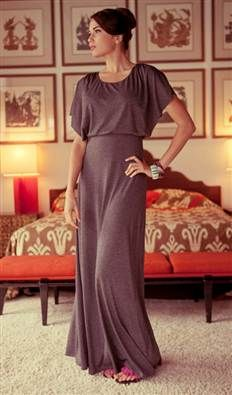 Made from a lush, soft jersey fabric and completed with a double-layered top and kimono sleeves, this maxi dress is the essence of easy dressing.  The charcoal, heather grey color connotes a modern feel.  A perfect outfit for lounging at home or a day in the desert.