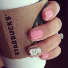 Bride-to-be holding a Starbucks coffee cup with pink and silver glitter nails.
