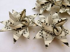 German Paper Origami Star Ornament Sculpture (3 inch, Vintage Music) - Might be able to make by double sided printing music on the computer. Could even scan some Christmas music and print it out.