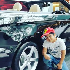 Champ with his dream machines: With an Audi A3 convertible at IGI T2.