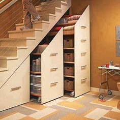Rolling shelving under the staircase is a great and neat way to use what could otherwise be idle space as additional storage