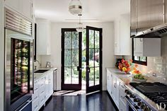 Hotelier Jeff Klein and movie producer John Goldwyn enlisted Madeline Stuart & Assoc. to rework the interiors of their Hollywood Hills house. The kitchen is equipped with pendant lights from BK Antiques, a Sub-Zero refrigerator, a Blanco sink with Kallista fittings, and a Viking range.