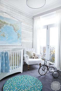 Charcoal grey carpet, a cute spot rug from Down That Little Lane and a retro bike are alluring drawcards in this boys' retreat.