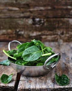Spinach   Though we can usually get spinach all year round, there's something satisfying about spinach from a local farm or picked from the garden. Spinach is rich in detoxifying chlorophyll and is a good source of vitamin E. Vitamin E is a potent antioxidant that most people don't get enough of in their diet.