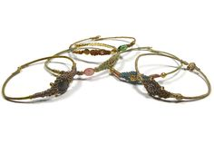 gold plated bangle bracelets with silk macrame, beads, charms, stones by www.sophisticatedgold.nl