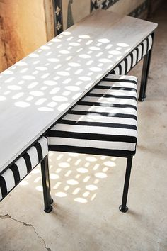 Form meets function with this bench and nesting ottomans. Instantly add seating to any room with this clever and comfortable alternative to the standard bench or coffee table. Black iron finish w/ white wash timber finish and upholstered dhurrie seating (Black and White).  Dimensions - Coffee Table Bench 149 L  x 37 D x 48  H - Individual Nesting Ottomans 43 L x 36  D x 42 H