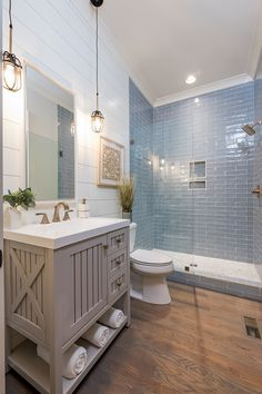 Coastal Farmhouse bathroom with shiplap walls, store-bought vanity and hardwood .,Coastal Farmhouse bathroom with shiplap walls, store-bought vanity and hardwood flooring and blue subway tile Neutral co. Modern Bathroom Design, Contemporary Bathrooms, Bathroom Interior Design, Bathroom Designs, Cottage Bathroom Design Ideas, Modern Interior, Shower Tile Designs, Coastal Interior, Modern Coastal