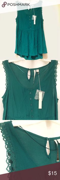 "LC Lauren Conrad Green Lace Popover High Low Tank Brand new with tags, available in women's size Small & Large. This Lauren Conrad Green Lace Popover High Low Tank is gorgeous! Has button detailing, flower lace detailing on the shoulders and eyelet hole in the back. Tank is longer in the back than the front. If you are 5' 2"" tall or shorter, it is possible to wear the size small as a dress. LC Lauren Conrad Tops Tank Tops"