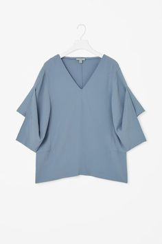 Top with draped sleeves
