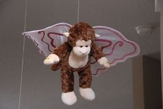 Wizard of Oz - flying monkeys hang from ceiling with fairy wings